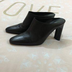 Calvin Klein black leather mules